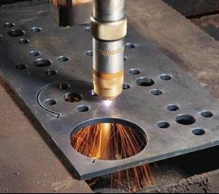 Plasma cutting circular holes in metal in Louth