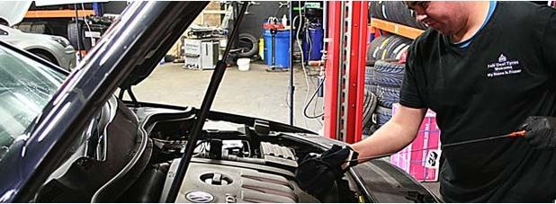 Image of mechanc working on car in Fair Deal Tyres in Naas.